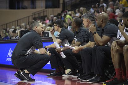 Maryland head coach Mark Turgeon, left, talks with his assistant coaches during the first half of an NCAA college basketball game against Harvard Friday, Nov. 29, 2019, in Lake Buena Vista, Fla. (AP Photo/Phelan M. Ebenhack)