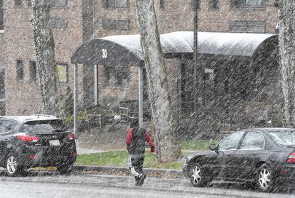 A light snow falls along Longwell Avenue in Westminster on Friday.