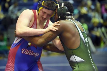 Lansdowne senior Thomas Weedon, left, recorded one of pins for the Vikings as they defeated Catonsville, 40-30, Tuesday night in a tri-meet at Woodlawn.