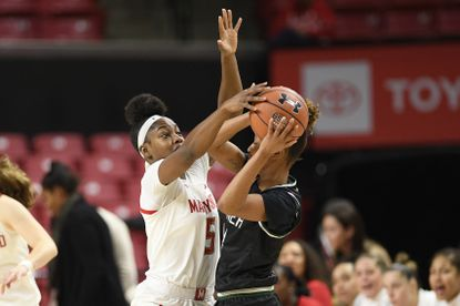 Maryland guard Kaila Charles (5) battles for the ball against Wagner forward Jordan Hobson, right, during the first half of an NCAA college basketball game, Tuesday, Nov. 5, 2019, in College Park, Md.