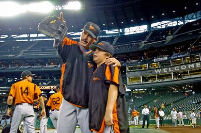 Rafael Palmeiro stands with his son Preston back in 2005, when Preston was 10 and his father was approaching 3,000 career hits. Eight years later, Preston could be picked out of high school in this week's amateur draft.
