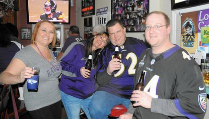 Ravens fans in Bel Air cheer their team on to playoff victory