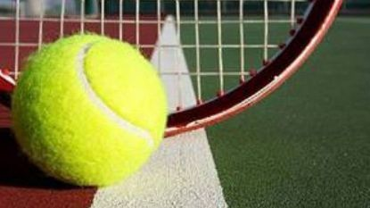 Tennis ball, racket, and court