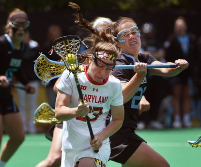 Maryland's Megan Whittle, left, battles Johns Hopkins' Maddie Bodden, right, in the first half. Maryland defeated Johns Hopkins,14-8, on May 7, 2016, in the NCAA women's lacrosse tournament.