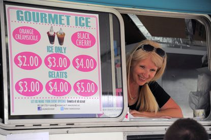 Tammy Radtke staffs the Miss Twist truck, serving frozen treats during the Taste of Two Cities food truck competition at Rash Field on June 1, 2014.