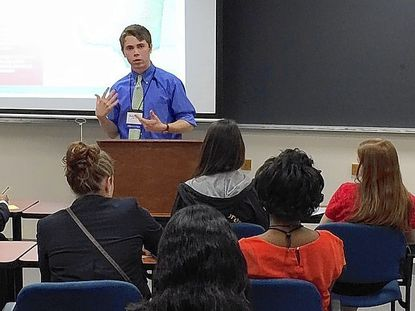 Daniel Ingham, a Wilde Lake High School senior, talks to students Friday about the challenges faced by African American Civil War soldiers in Howard County once the war ended.