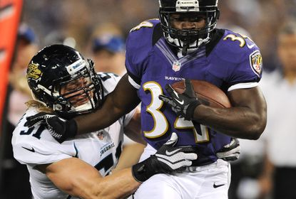 Running back Bobby Rainey #34 of the Baltimore Ravens eludes linebacker Paul Posluszny #51 of the Jacksonville Jaguars in the second quarter at M&T Bank Stadium in August.