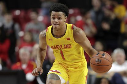 Maryland guard Anthony Cowan Jr. (1) dribbles up court against the Oakland during the second half of an NCAA college basketball game, Saturday, Nov. 16, 2019, in College Park, Md. Maryland won 80-50. (AP Photo/Julio Cortez)