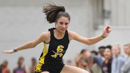 South Carroll's Brooke Flanigan clears the final hurdle in the girls 55-meter hurdles during the Western Maryland Winter Classic meet at Hagerstown Community College on Jan. 4, 2019.
