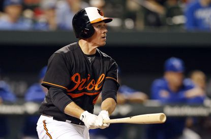 Former OriolescatcherSteve Clevenger watches his grand slam during the eighth inning against the Kansas City Royals on Sept. 11, 2015 in Baltimore. The Orioles acquired outfielder/first baseman Mark Trumbo and left-hander C.J. Riefenhauser from the Seattle Mariners for Clevenger, Wednesday, Dec. 2, 2015.