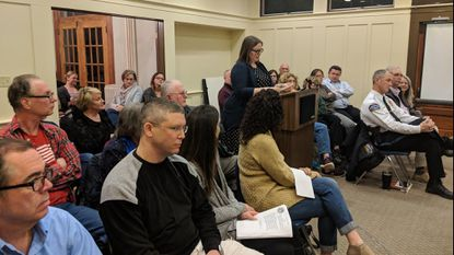 Sykesville Town Clerk Kerry Chaney reads comments from residents regarding the 714 Sandosky Property into the record at the Jan. 28 public hearing at the Sykesville Town House.