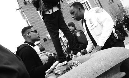 Duane Bond Jr., President of the University of Baltimore Student Government Association, confronts police at camden yards.