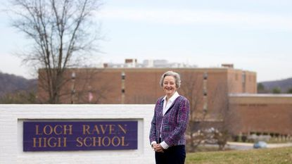 Towson resident Laurie Taylor-Mitchell stands in front of Loch Raven High School, where she started the Loch Raven Network, to fight food insecurity in Baltimore County Public Schools.