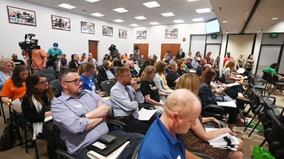 Attendance at the first of three planned public hearings on the proposed Howard County school redistricting plan being held at the school board center office.
