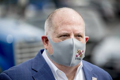 In this Friday, May 15, 2020, file photo, Maryland Gov. Larry Hogan wears a mask with the Maryland state flag on it following a tour of Coastal Sunbelt Produce in Laurel.