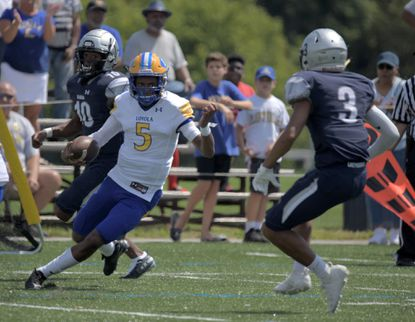 Through nine games, Loyola Blakefield quarterback Jordan Moore has rushed 99 times for 606 yards and scored seven rushing touchdowns.