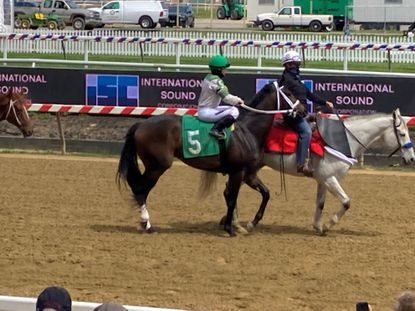 Jockey Katie Davis heads for the Pimlico starting gate for the 5th race on May 6 aboard the filly Hope Has A Name.