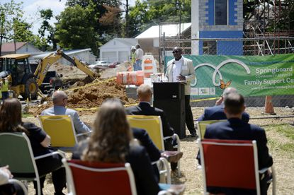 F.T. Burden, CEO of Springboard Community Services speaks at a groundbreaking ceremony for the new Family Support Center adjacent to West End Place in Westminster Tuesday, May 18, 2021.