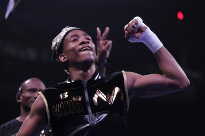 Malik Warren reacts after defeating Devonte McCowen by TKO during the second round of their super featherweight boxing bout, Saturday, July 27, 2019, in Baltimore. (AP Photo/Julio Cortez)