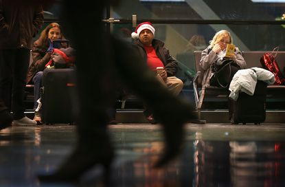 Passengers hang out at O'Hare International Airport Friday in Chicago. Today, the busiest air travel day of the Christmas holiday, an estimated 200,000 travelers are expected to travel through O'Hare Airport.