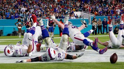 Buffalo Bills defensive tackle Kyle Williams (95) and a group of players fall to the ground in celebration after Williams scored a touchdown, during the second half against the Miami Dolphins, Sunday, Dec. 31, 2017, in Miami Gardens, Fla.