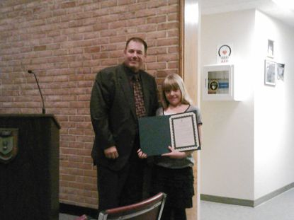 Finley Moreland, a fifth grader at Bel Air Elementary School, was honored by the town commissioners Monday night and receives a student achievement award from Bel Air Mayor Eddie Hopkins.