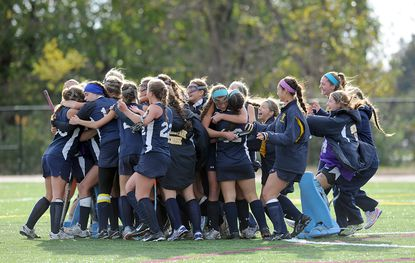 Severna Park celebrates winning their 22nd state championship. The Severna Park Falcons defeated the Bethesda Chevy Chase Barons, 4-1, in the MPSSAA state field hockey championship game.