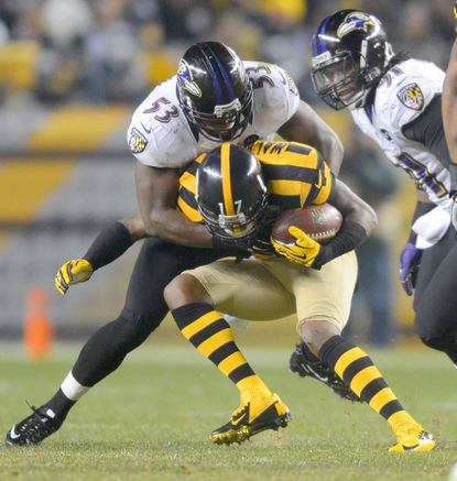 Jameel McClain wraps up Pittsburgh wide receiver Mike Wallace last week. The Ravens' inside linebacker has been a key factor against the pass this season.