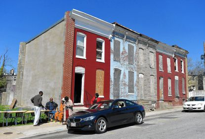 Local activists have taken over an abandoned home across the street from where Freddie Gray was arrested.