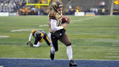 Former Western Michigan quarterback Tom Flacco rushes for a 13-yard touchdown in 2015 against Toledo.