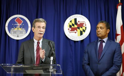Maryland Attorney General Brian Frosh, left, accompanied by District of Columbia Attorney General Karl Racine, speaks during a news conference in Washington on June 12, 2017.