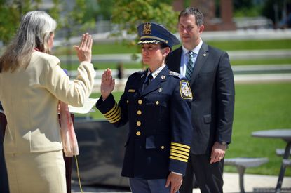 Baltimore County Police Chief Melissa R. Hyatt is sworn in by Julie Ensor the Clerk of the Court for Baltimore County at Patriot Plaza in Towson. She is the first woman to hold this position in Baltimore County. John Olszewski the Baltimore County Executive took part in the ceremony.