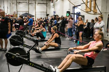 Century graduate Emily Kain, right, participates in a CrossFit breast cancer awareness competition in October, 2019.