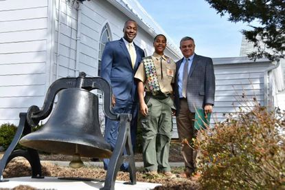 Xavier Cook, center, with County Executive Calvin Ball, left, and District 5 Councilman David Yungmann and his Eagle Scout project.
