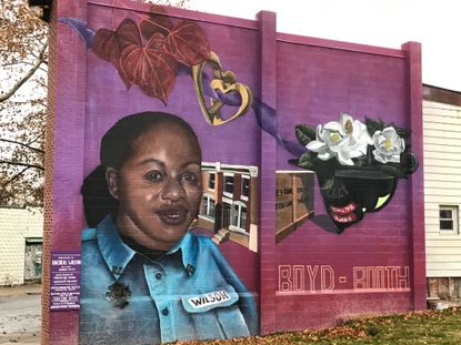 A mural pays homage to Racheal Wilson, a firefighter who died during a training exercise in 2007, in the park that bears her name in Boyd-Booth.