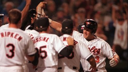Orioles catcher Chris Hoiles celebrates with teammates after hitting a grand slam home run against the Seattle Mariners in the ninth inning to win the game in May 1996.