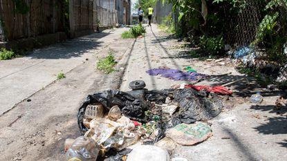 Litter in an alley near Bocek/Madison East End in Baltimore. (Ulysses Muñoz/Baltimore Sun).