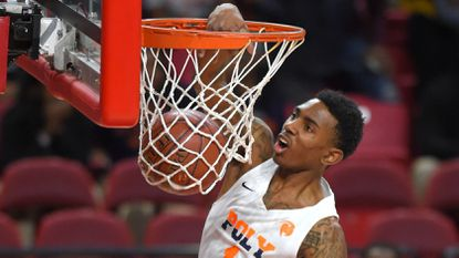 Poly's Demetrius Mims dunks against Stephen Decatur in the Class 3A state semifinals at the University of Maryland's Xfinity Center in 2018.