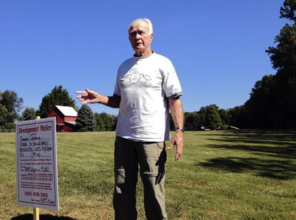 John Roberts, owner of this 13.5-acre parcel off Fountain Green Road, is selling the land for housing development. The barn behind him will be torn down to build an access road to what will be called the Roberts Crossing subdivision.