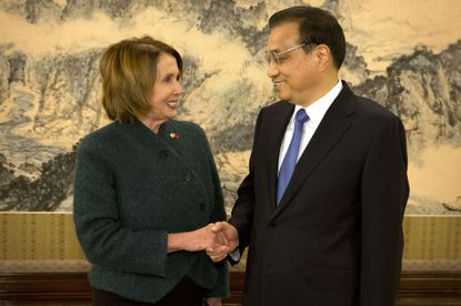 U.S. House Minority Leader Nancy Pelosi shakes hands with Chinese Premier Li Keqiang as she arrives for a bilateral meeting at the Zhongnanhai leadership compound in Beijing on Nov. 13, 2015. Pelosi and six other Congress members recently visited Tibet.