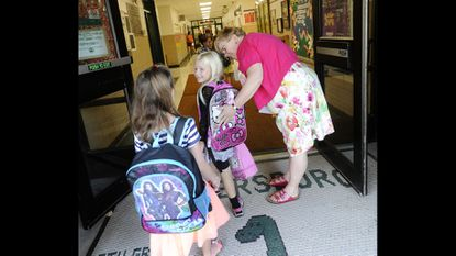Teachers and staff greet new and returning students at Eldersburg Elementary