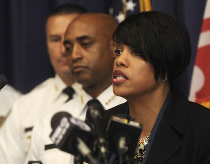 Baltimore Mayor Stephanie Rawlings-Blake and city police commissioner Anthony Batts discuss police reforms at October news conference. Barbara Haddock Taylor/Baltimore Sun