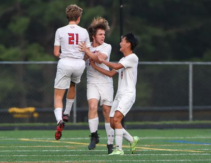 Centennial's Adam Fowble (16) celebrates with teammates after scoring in the second half. Mt. Hebron hosts Centennial High School boys soccer on Tuesday, September 14. ]