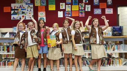 Girl Scouts are hosting an exhibition at the Eldersburg library. From left: Rachel Carpenter, Morgan von Lunz, Charlotte Daniel, Casey Latzlsberger, Paige Simms, Leah Vaughan, and Amelia Baity. (Not pictured: Sophia DeLuca, Addie Ingallina, Lisa Rumbel, Makenna VanderVeer.)