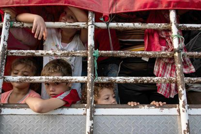 Honduran migrant children heading in a caravan to the U.S., travel on a truck near Pijijiapan, Mexico last year. File.