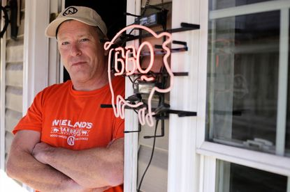 Mark Wieland, owner of Wieland's Barbeque, poses while renovating the food truck's new sit-down space on Frederick Road in downtown Catonsville.