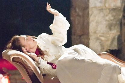 Lucy Seward (Blythe Coons) grows tormented as Dracula's command over her threatens her life and all who love her in Chesapeake Shakespeare Company's 'Dracula' at the Patapsco Female Institute in Ellicott City.