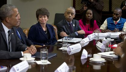President Barack Obama speaks to the media at a meeting with civil rights leaders in the Roosevelt Room of the White House in Washington, Thursday, Feb. 18, 2016. From left are the president Rep, John Lewis, D-Ga., Senior White House Adviser Valerie Jarrett, Al Sharpton, Founder and President of the National Action Network, Sherrilyn Ifill, President of the NAACP Legal Defense Fund, and in the blue vest is Deray McKesson, Co-Founder of We the Protestors and Campaign Zero.