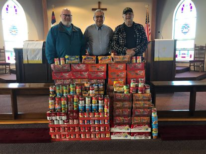 """For the 10th year, Deer Park United Methodist Church celebrated """"Souper Bowl"""" Sunday by collecting donations of canned and packaged soup. Pastor John Dean (center) and church members Richard Baker, to his right, and Gary Saylor are pictured with the soup collected."""
