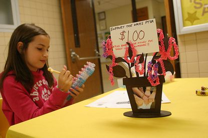 Jackie Flam creates pink bracelets to fund the Breast Cancer Research Foundation at Owings Mills High School Oct. 10.